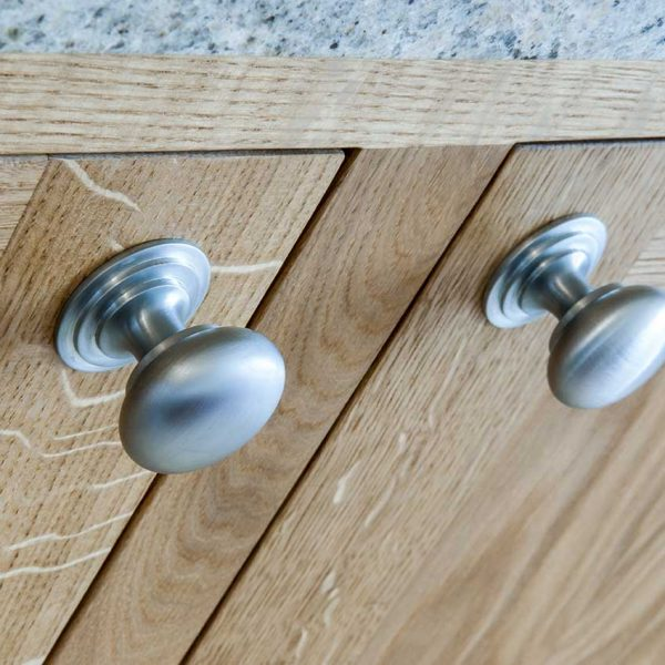 close-up-kitchen-handles-on-wooden-brown-doors (341484590)