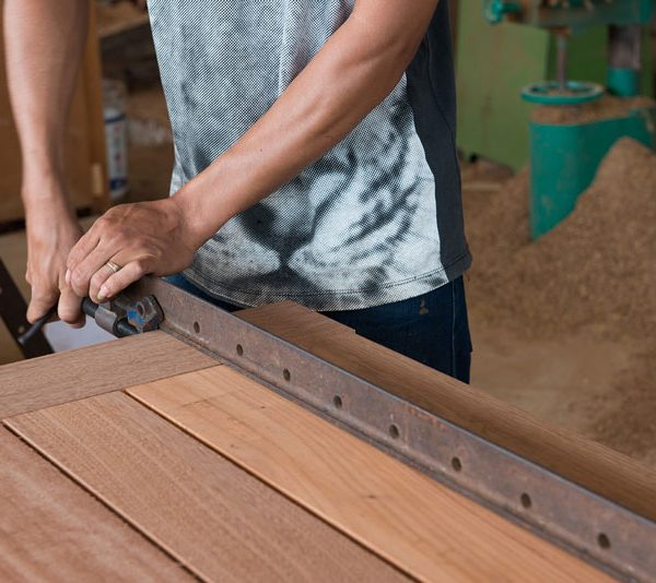 close-up-man-making-melamine-doors-in-workshop