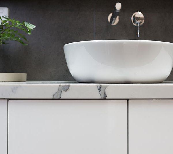 close-up-of-custom-bathroom-vanity-marble-top-white-basin