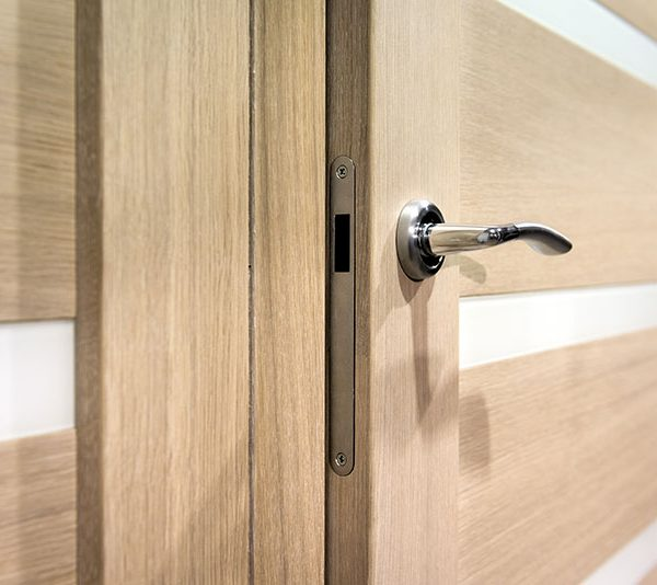 close-up-wooden-door-handle-and-frame
